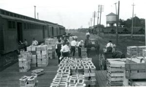 Farmers load produce on the fruit train